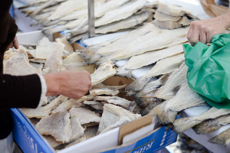 Fish market stall with salted codfish, traditional portuguese bacalhau Stock Photo - 145392763