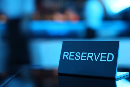 formal place setting: Reserved card sitting on a formal place setting