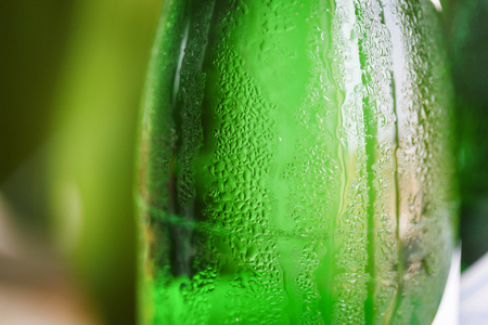 single beer bottle: Green glass bottle with condensation on it Stock Photo
