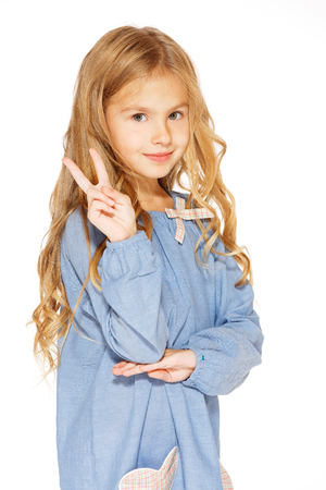 Little girl posing for the camera with the peace sign