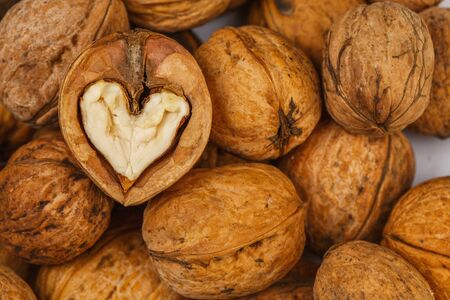 heart white: Walnut heart shaped on table. Healthy food