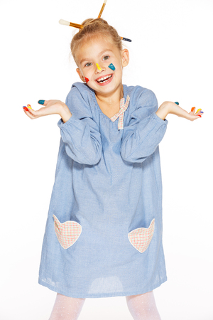 multi age: A little painter with colored fingers and a charming smile