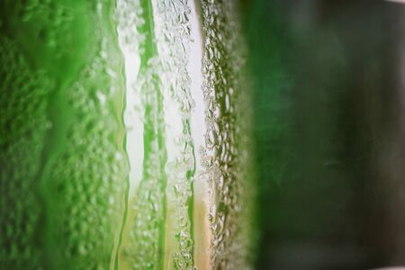 condensation: Green glass bottle with condensation on it Stock Photo