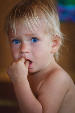 15 18: Cute little baby with heavenly blue eyes
