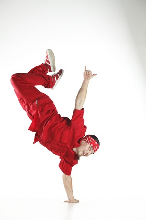 sport clothes: Young men dancer doing jumps and difficult elements
