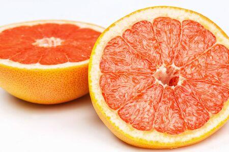 Slice a fresh juicy red round grapefruit Stock Photo