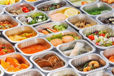 Separate portions of different food into containers Stock Photo