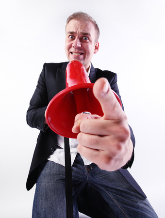 bad leadership: A crazy businessman shouting through a megaphone