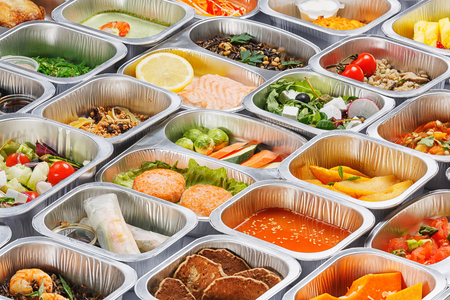 Separate portions of different food into containers Reklamní fotografie