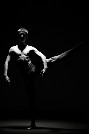 male ballet dancer: Creative picture with dancer in motion - Black and white image