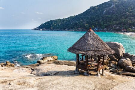 wooden hut: Wooden hut on a rocky beach in Thailand
