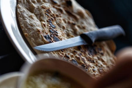 pita bread: Pita bread with knife in restaurant in Thailand Stock Photo