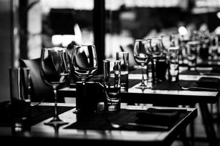 Table setting in restaurant with wine and water glasses