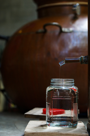 boiling tube: Rum distillery in Manufacture in Cambodia, vertical Stock Photo