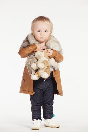sheepskin: Girl in sheepskin coat on a white background
