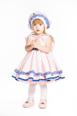 multi age: Little girl in a pink dress lake a sailor