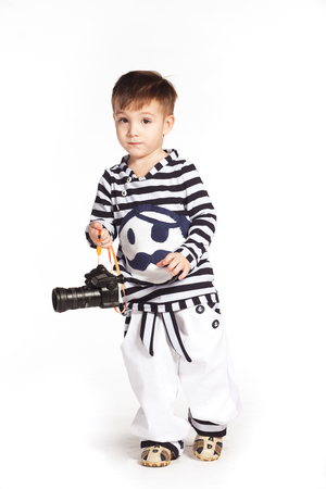 multi age: Boy in the sailor suit with camera in his hands