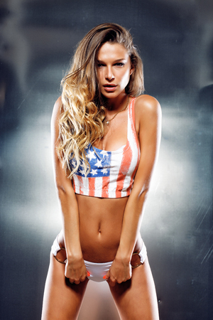 american: Very sexy girl in a lingerie with American flag Stock Photo