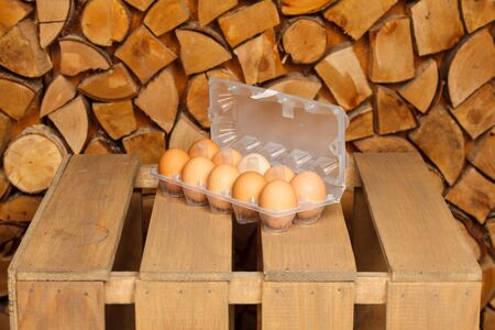 dozen: Dozen of brown eggs on brown wooden stand