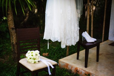 prewedding: Preparations for the wedding - white dress and shoes Stock Photo