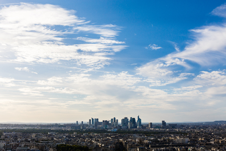 The capital of France under blue sky with white clouds