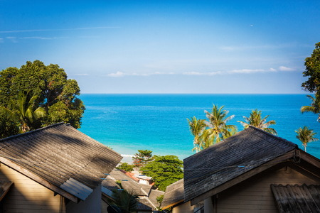 The roof of the Bungalow with blue sea and green trees