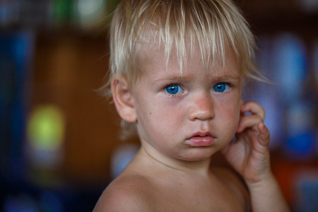 honey blonde: beauty blonde young boy with blue eyes in thailand Stock Photo