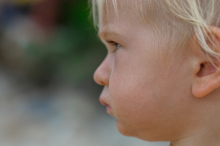 only boys: Baby with blond hair and blue eyes on the beach