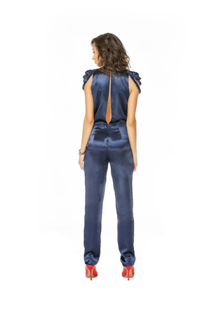 blue overall: Back view of a model standing in blue overall Stock Photo