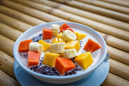 Sweet fruit dessert with exotic fruits in Thailand