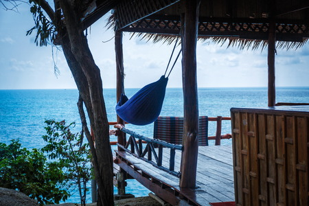 Beachhut with hammock under the roof in Thailand Stock Photo