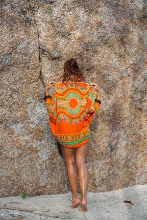 ropa de verano: Attractive woman in summer clothes on brown rock background Foto de archivo