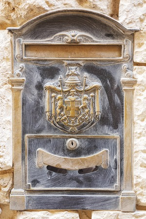 mail slot: Old historical bronze brass letterbox in Malta Stock Photo