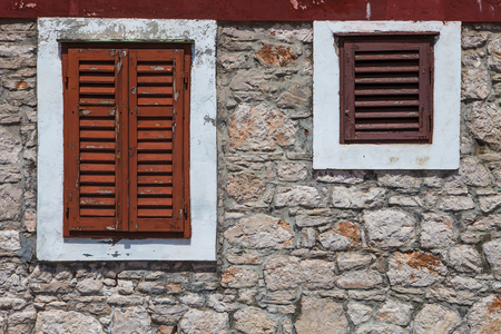 pannel: Grunge textured old wall with orange shutters Stock Photo