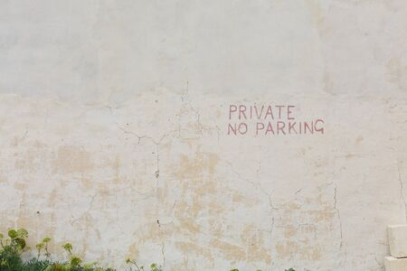 pannel: Grunge textured old wall background with no parking sign