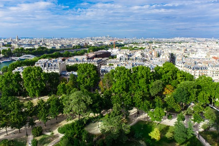 famous industries: The capital of France under blue sky with white clouds