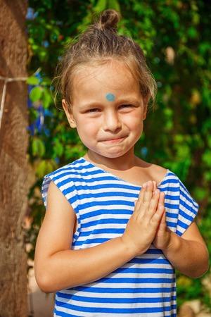 third eye: Very beautiful boy as a Buddha with a third eye