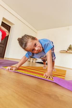 dhanurasana: Little boy on a yoga class Stock Photo