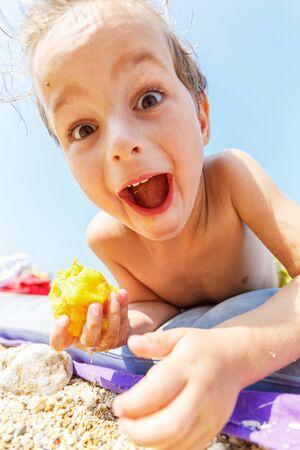 Boy eating a peach Stock Photo