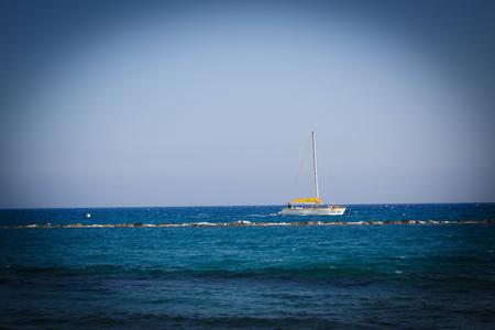 shipbuilding: White alone ship at the blue sea