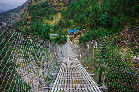Suspension bridge in the mountains in Nepal
