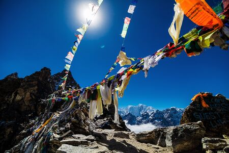 Colorful flags in the mountains of Nepal Stock Photo