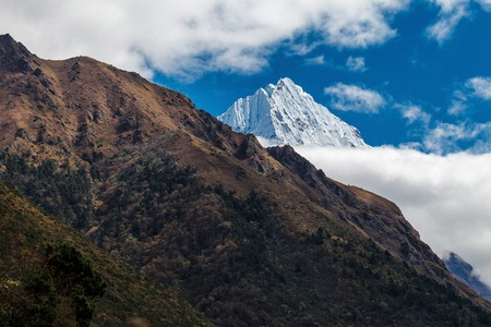 The peak of the snowy mountains in the clouds Stock Photo