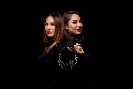 Beautiful girls twins-dj 写真素材