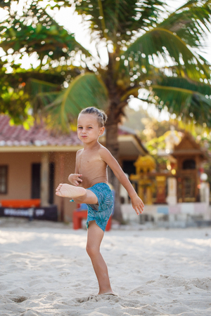 Boy playing flying disk on the beach