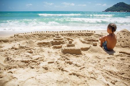 little boy built a sand castle Stok Fotoğraf