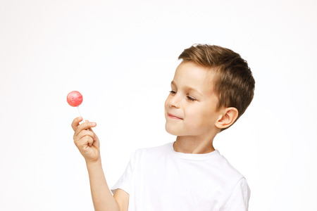 little boy with a lollipop on a white background Stock fotó