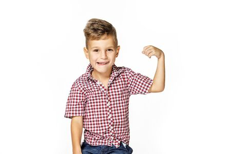 handsome boy shows his strength on white background Stok Fotoğraf