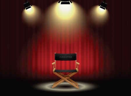 at the theater: background curtain and directors chair with spotlight