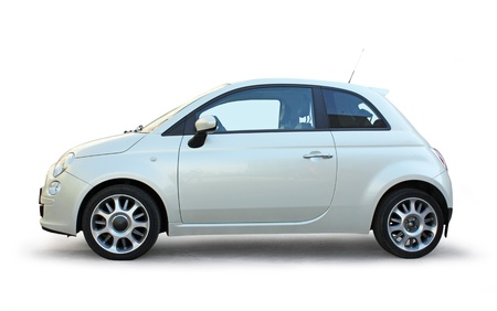 Small stylish car side view on white background